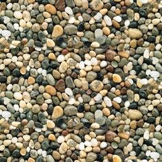 This landscape medley brown river rock pebbles smooth stones cotton fabric from Elizabeth's Studio is available by the yard or fat quarter at Fabrics