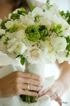 Stoneblossom Florals' White Roses and Ranunculus Bouquet with accents of greenery ~ Ranunculus symbolize charm.
