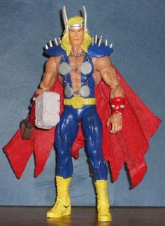 this is a marvel legends Dargo Ktor Custom Action Figure he was made by figure realmer offeros_reprobus he used a wwf elite triple h body, and thor head.and a imprint from the thor belt buckle, spawn cape, mjolnir is the lord of asgard thor, jewelry chain, toybiz wolverine spikes, and teeth from an alien figure happy pinning