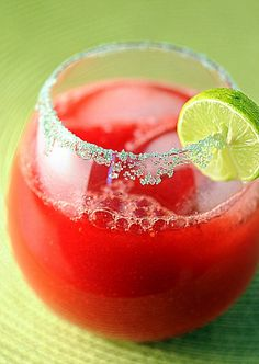 Key Lime Raspberry Margarita 1 cup tequila 1½ cup orange liquor ½ cup frozen raspberries 1 cup key lime juice 1/3 cup superfine sugar Into the blender they go. Blend on high until fully combined and the raspberry seeds have gone bye-bye. Pour into a glass that is rimmed with salt. Serve with ice as this is not a frozen margarita.