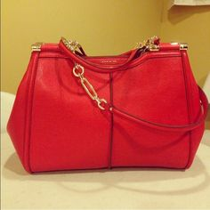 New without tags Coach Madison Caroline bag! Brand-new without tags Coach Madison Caroline bag in bright red! Light gold colored hardware! Beautiful details. Bag made of saffiano leather with silk lining! Coach Bags Shoulder Bags