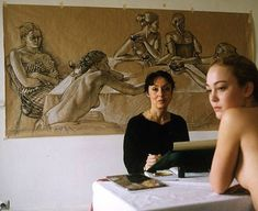 Artist Francine Van Hove  with Model and drawing in background