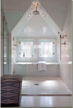 What a fantastic shower! Wonderful job of incorporating the angels and eaves of the house into the shower's design. Love the lighting too.