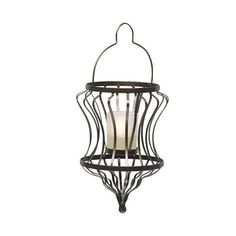 "Exotic shape lends a worldly flair to your outdoor entertaining areas. Add a tealight or votive, sold separately, for a welcoming glow. Metal with folding handle and frosted glass votive cup. Hanging hardware not included. 12 1/4""h, 4 3/4""dia.  Price:  $25.00 each"
