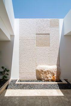 Modern Living Spaces // Atrium Stone wall at the Mamilla Residence | Matti…