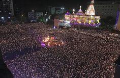 Indian devotees take part in the Maha Aarti ritual at Hindu deity Umiya Mata temple on the eighth night of Navratri (nine nights) festival in Surat, India. (AP)