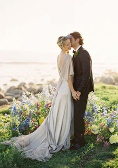 I LOVE everything about this one! Dress, grass, flowers, beach.. :) My ideal perfect wedding if I ever do it again. Simple, elegant and small so its personal