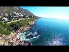 Drone video footage of Gordons Bay cliffs and the Suikerbossie Road side of Gordons Bay (start of Clarence Drive) & the Platinum Mile side of Strand Beach Road - taken between the Pavillion and Odeon apartment block n Blakes beach - Strand. #Strand #BeachRoad #Odeon #GordonsBay  #Suikerbossie