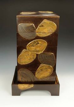 Japanese tiered box decorated with clam shells used in the shell matching game (kai awase) in high-relief lacquer (takamaki-e), 19th century