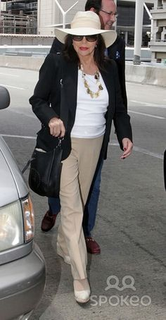 Asset Caption|Joan Collins arrives at Los Angeles International Airport (LAX)
