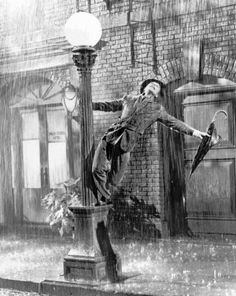Gene Kelly performs in the 1952 film ``Singin' in the Rain''. Kelly, a dancer and choreographer who brought his athletic grace and Irish charm to ``Singin' in the Rain