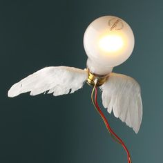 Designed by Ingo Maurer, Germany. Brass, feathers and plastic. Ingo Maurer, Light Bulb, Germany, Table Lamp, Lights, How To Make, Home Decor, Feathers, Plastic