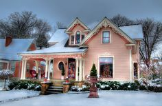 Love this pink house!  Lots of charming gingerbread on this Victorian cottage.