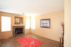 Open concept from the kitchen to the family room area with gas fireplace in the living room. Diamond Realty & Associates Ltd. Tiered Deck, Corner Pantry, Large Sheds, Selling Real Estate, Large Bedroom, Gas Fireplace, Open Concept, Home Buying, Open House