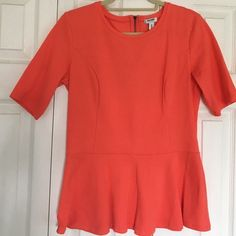 "Old Navy Orange peplum cotton stretch top Old Navy size Medium Tall (for length in the body) orange Peplum top with back zipper detail. Sleeves hit at the elbow. 97% cotton, 3% spandex for added comfort. Measures 26"" shoulder to hem and 18"" lying flat armpit-armpit Old Navy Tops Tees - Short Sleeve"