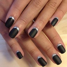Matte black nails with silver trim!  Cute for the fall :)