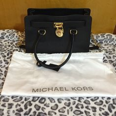 Michael Kors Hamilton Authentic. Dust bag included. Might have tags. Medium size. Color is black with gold hardware. No flaws. Saffiano leather. Snap closure with a zipper pocket and two slip pockets. Michael Kors Bags Satchels