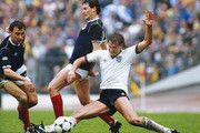 England player Glenn Hoddle (r) challenges Jim Bett of Scotland as Maurice Malpas (l) looks on during a Home international match between Scotland and England at Hampden Park on May 25, 1985 in Glasgow, Scotland.
