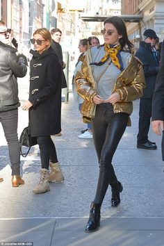 Kendall Jenner bundles up in striking gold puffer jacket #dailymail
