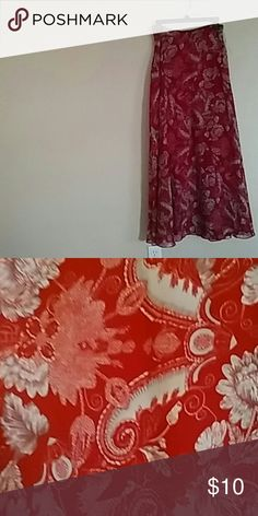 FLOWER LONG SKIRT. LONG SKIRT. MULTICOLOR FLOWER SKIRT. GORGEOUS. SHELL IS POLYESTER. LINING POLYESTER. GREAT FOR ANY OCCASION. Lucy Paris Skirts Maxi