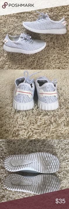 Fake Yeezys White/Silver Fake Yeezys. Size 9. Worn once. Very comfortable. Just do not reach for them anymore. Very cute. Looks like the real thing. Silver flecks in the fabric. Shoes Sneakers