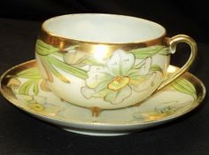 Antique Nippon Japan ITSY-4 Feet  Tea cup and saucer