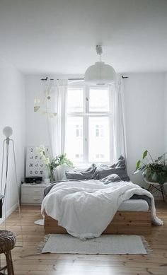 things i love about this: platform bed; white, grey and wood color scheme; plants; minimalist feel