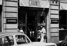 Coco Chanel outside her apartment with boutique showroom at street level, 31 Rue Cambon, Paris