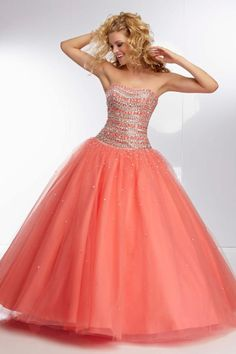 """Start out searching for your perfect long maxi strapless orange prom dress by flipping through magazines and online to see what kind of dress you are most attracted to. Then hit the stores with an idea in mind of what you are looking for. Try on as many dresses as you can; your idea of the """"perfect dress"""" may not be as well suited for you as another style. Don't limit yourself."""