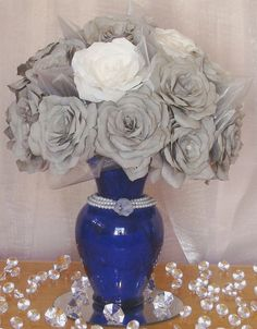 Navy blue wedding centerpiece with grey and white handmade coffee filter flowers, organza and pearls.