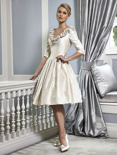 A timeless elegant Mother of the Bride & Mother of the Groom dress from the Portofino 2016 Collection by Ian Stuart London. This dress features a ruched rose flower neckline and has been beautifully designed using a silk dupion fabric. Product code ISL669. View more Mother of the Bride / Groom dresses from our Ian Stuart collection at: http://www.baroqueboutique.co.uk/mother-of-the-bride-south-wales/ Photographs courtesy of: http://www.ianstuart-london.com/