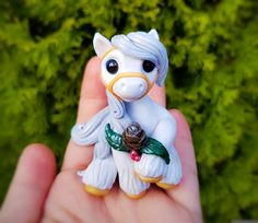Christmas White Holly Pinecone  Filly By Whisper Fillies Whisperfillies.etsy.com Unique handmade polymer clay horse, pony, unicorn and fantasy creatures  Find me on Instagram and Facebook too!