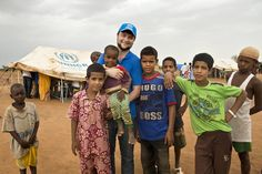 Hugo and the kids in Mentao refugee camp, northern Burkina Faso. August 2012 / UNHCR / H. Caux