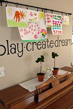 cute way to display children's artwork - curtain rod, hooks, and wall word decals saying play, create, and dream. For playroom Art Wall Kids, Diy Wall Art, Art For Kids, Kid Art, Hang Kids Artwork, Hanging Kids Art, Kids Work, Hanging Artwork, Displaying Childrens Artwork