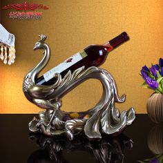 https://www.aliexpress.com/store/product/European-classical-resin-crafts-Phoenix-multipurpose-fruit-wine-rack-KTV-practical-hotel-decoration/219022_32737275011.html?spm=2114Find More Figurines & Miniatures Information about 2016 Direct Selling Home Decora