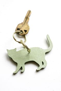 mint green leather cat keychain by cutpath