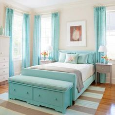 Seaside Fresh:   Evoke oceanside serenity with crisp turquoise accents layered on a sea of white. Shades of gray found on painted side tables, a striped floor rug, and a cotton throw keep this bedroom's bright palette from floating away.