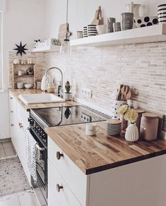 A white or black stove top cover in this quaint kitchen would add more countersp. A white or black stove top cover in this quaint kitchen would add more counterspace. Click the photo to find one cus Home Decor Kitchen, New Kitchen, Kitchen Interior, Home Kitchens, Kitchen Dining, Open Shelf Kitchen, Bohemian Kitchen Decor, Galley Kitchen Design, Small Galley Kitchens