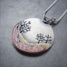 love this mixed metal work pendant