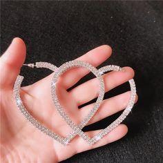 Metals Type: Copper AlloyGender: WomenSize (Length * Width): 45mm * 30mmEarring Type: Hoop EarringsItem Type: EarringsMaterial: CrystalFine or Fashion: FashionColor: Sliver/RhinestoneShape: HeartMetals Type: AlloyItem Type: Hoop EarringsWomen Fashion Drop Earrings: Heart Hoop Earrings Heart Shaped Earrings, Rhinestone Earrings, Silver Hoop Earrings, Crystal Earrings, Women's Earrings, Jewelry Party, Jewelry Gifts, Glamour Fashion, Fashion Fashion