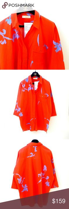 NWT Tory Burch Orange Blue Dolman Sample Top NWT Tory Burch Orange Blue Dolman Sample Top Spring 2016, 100% cotton, frocket Excellent, new condition. Feel free to ask me any additional questions! No trades, or modeling. Reasonable offers considered. Happy Poshing! Tory Burch Tops