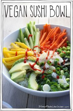 Vegan Sushi Bowl! Like a deconstructed sushi roll. So healthy and easy to make! Just cook some sushi rice, thinly slice the veggies, mango, avocado and seaweed, sprinkle with sesame seeds and enjoy! #itdoesnttastelikechicken