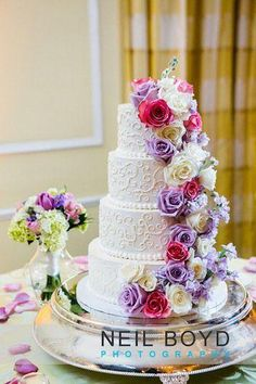 Buttercream wedding cake with cascading flowers.
