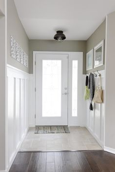 White mud room with dark wood floors