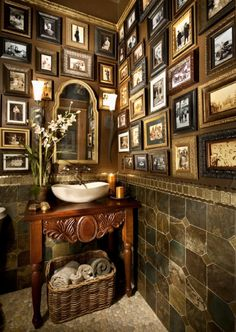 not crazy about the tile (?) bottom part but i love the idea of framing old photos in the bathroom.