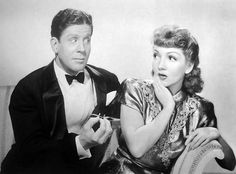 """Rudy Vallee and Claudette Colbert. """"The Palm Beach Story"""" 1942."""