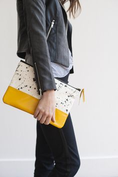 So great how this mustard yellow tone really knows how to make the splatters on this bag stand out.