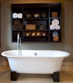 claw foot tub-- love the shelving next to it, very nifty!