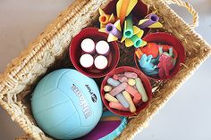basket of outside toys for the kiddos (outdoor entertaining area idea)