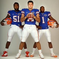 Tebow poses with teammates Brandon Spikes (51) and Percy Harvin (1) 2008